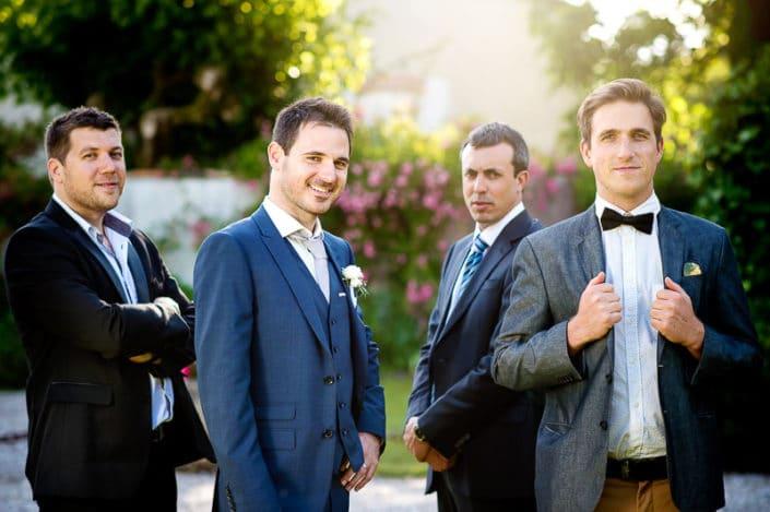photo groupe homme durant un mariage